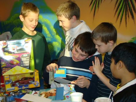 Birthday boy opening gifts