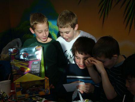 Birthday boy opening gifts 2