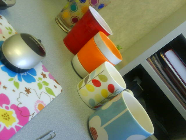 Cute cups on desk