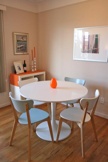Kate - white + orange dining area