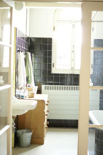 Charming bathroom via wood and wool stool